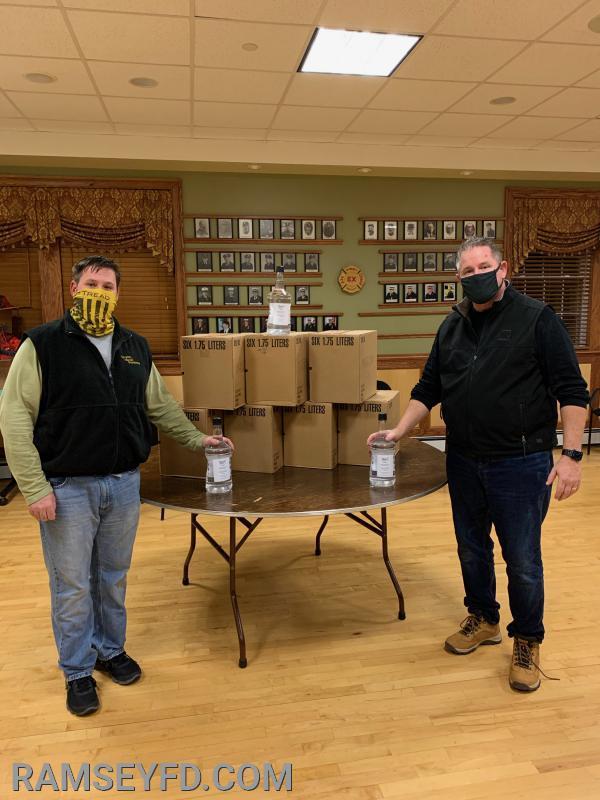 Chief Jon Krehel (L) President Greg Hewitt (R) showing the bottles of Hand Sanitizer